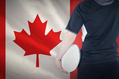 Composite image of back turned rugby player holding a ball Stock Photography