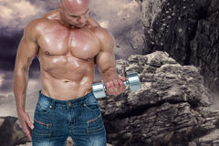 Composite image of bald man lifting dumbbells Stock Photo