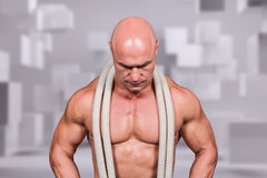 Composite image of bald man with rope around neck Stock Photography