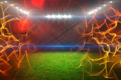 Composite image of ball of fire 3d. Ball of fire against digitally generated image of illuminated floodlight on playing field 3d Stock Photography