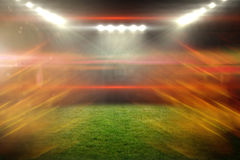 Composite image of ball of fire 3d. Ball of fire against illuminated soccer stadium 3d Stock Image