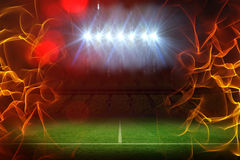 Composite image of ball of fire 3d. Ball of fire against pitch under illuminated spotlights 3d Stock Photo