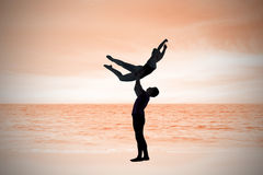 Composite image of ballet partners dancing gracefully together Stock Image