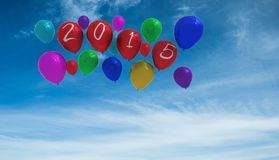 Composite image of 2015 balloons. 2015 balloons against blue sky Royalty Free Stock Images