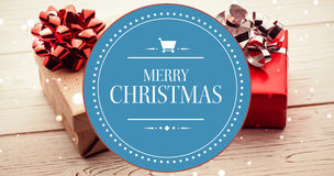 Composite image of banner and logo saying merry christmas Royalty Free Stock Photo