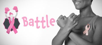Composite image of battle text with female likeness and breast cancer awareness ribbon royalty free stock photo
