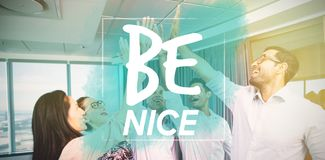 Composite image of be nice. Be nice against business colleagues giving high five during meeting in office Stock Photo