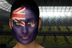 Composite image of beautiful australia fan in face paint Stock Images