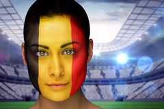 Composite image of beautiful belgian fan in face paint Royalty Free Stock Photo