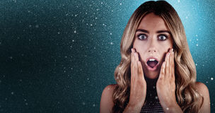 Composite image of beautiful blonde woman being shocked Royalty Free Stock Photos