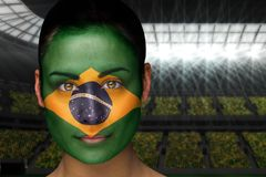 Composite image of beautiful brasil fan in face paint Stock Photos