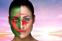 Composite image of beautiful brunette in algeria facepaint Stock Photography