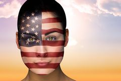 Composite image of beautiful brunette in america facepaint Royalty Free Stock Image