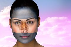 Composite image of beautiful brunette in argentina facepaint Royalty Free Stock Photography
