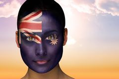 Composite image of beautiful brunette in australia facepaint Royalty Free Stock Images