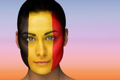 Composite image of beautiful brunette in belgium facepaint Stock Image