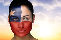 Composite image of beautiful brunette in chile facepaint Stock Image