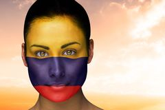 Composite image of beautiful brunette in colombia facepaint Royalty Free Stock Images