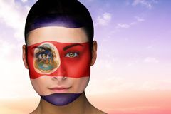 Composite image of beautiful brunette in costa rica facepaint Stock Photos
