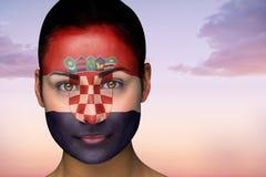 Composite image of beautiful brunette in croatia facepaint Stock Photo