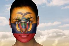Composite image of beautiful brunette in ecuador facepaint Stock Photo
