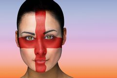Composite image of beautiful brunette in england facepaint Stock Photos