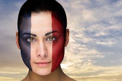 Composite image of beautiful brunette in france facepaint Royalty Free Stock Images