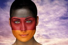 Composite image of beautiful brunette in german facepaint Stock Images