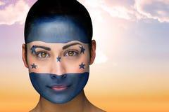 Composite image of beautiful brunette in honduras facepaint Royalty Free Stock Image