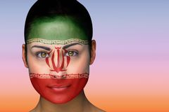 Composite image of beautiful brunette in iran facepaint Stock Image