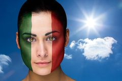 Composite image of beautiful brunette in italy facepaint Stock Image