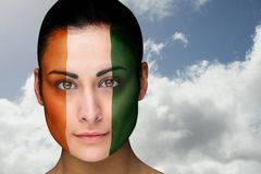 Composite image of beautiful brunette in ivory coast facepaint Royalty Free Stock Photography