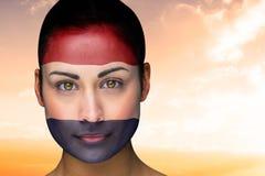 Composite image of beautiful brunette in netherlands facepaint Stock Photos
