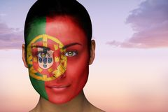 Composite image of beautiful brunette in portugal facepaint Royalty Free Stock Photography