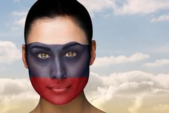 Composite image of beautiful brunette in russia facepaint Stock Image