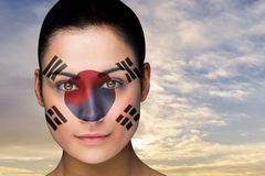 Composite image of beautiful brunette in south korea facepaint Stock Photos