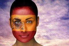 Composite image of beautiful brunette in spain facepaint Stock Photos