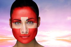 Composite image of beautiful brunette in swiss facepaint Stock Photo