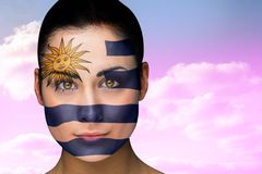 Composite image of beautiful brunette in uruguay facepaint Royalty Free Stock Photos