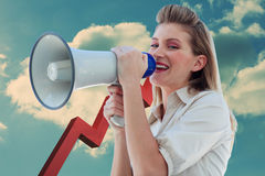 Composite image of beautiful businesswoman shouting through megaphone Stock Photography