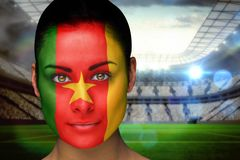Composite image of beautiful cameroon fan in face paint Stock Photography