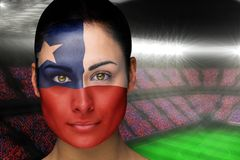 Composite image of beautiful chile fan in face paint Royalty Free Stock Images