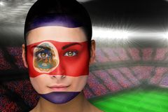 Composite image of beautiful costa rica fan in face paint Royalty Free Stock Photography