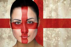Composite image of beautiful england football fan in face paint Royalty Free Stock Images