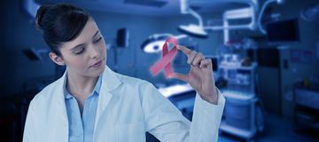 Composite image of beautiful female doctor gesturing. Beautiful female doctor gesturing against empty operation room Stock Images