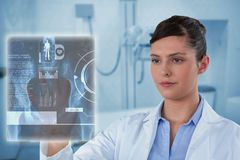 Composite image of beautiful female doctor using imaginative screen 3d Royalty Free Stock Photography