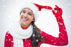 Composite image of beautiful festive woman smiling at camera Stock Photo