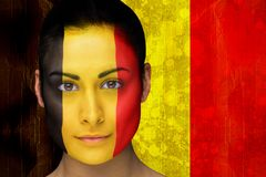 Composite image of beautiful football fan in face paint Stock Images