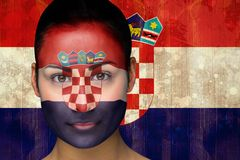 Composite image of beautiful football fan in face paint Stock Photo