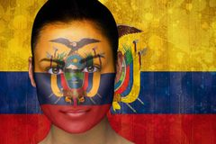 Composite image of beautiful football fan in face paint Royalty Free Stock Photos
